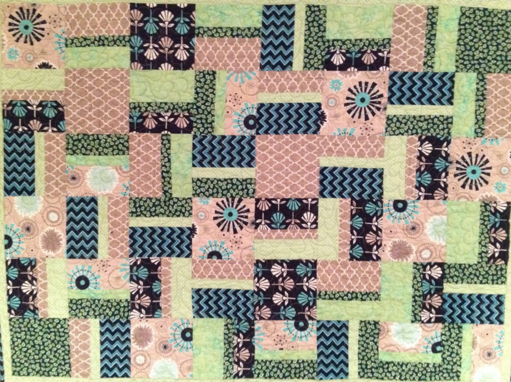 mint, gray, and navy blue nursery quilt